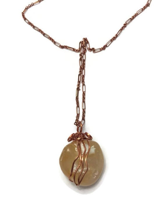 Light Amber (almost colorless) agate pendant with copper wire
