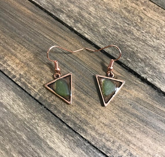Unique copper triangle earrings with pale green sea glass embedded in resin