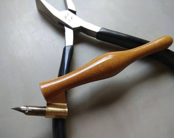 Bakelite hylam mini oblique holder.