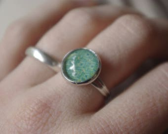 Blue-green ring with a glass cabochon