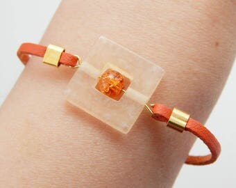 Orange leather bracelet with glass bead and resin