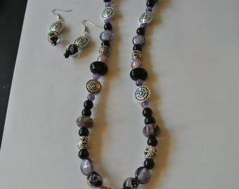 Purple and Black Beaded Necklace with Purple and Silver Pendent