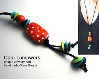 Long, orange polka dot chain, ceramics, wood