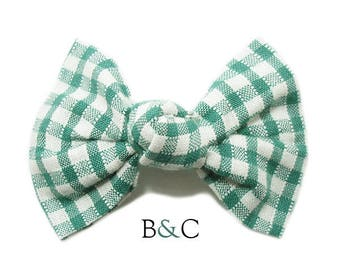 Hair bow tied green gingham.