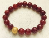Bracelet - Starlight Stretch rust red agate with gold accent bead