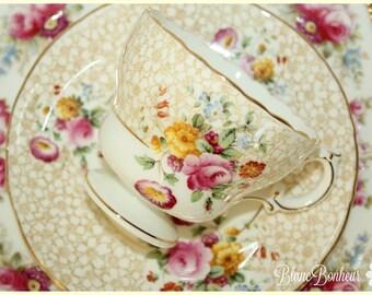 Cauldon, England: Tea cup & saucer with colorful flowers