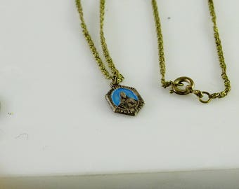 "Antique Religious Pendant Petite on a 18"" Chain Not marked sterling"