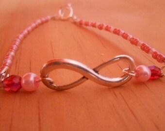 Infinity symbol wedding bracelet and pink beads