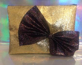 Gold glitter embellished clutch bag