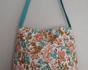 Large flowers and leather strap bag