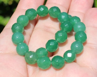 2 faceted Emerald round 7 mm AT22