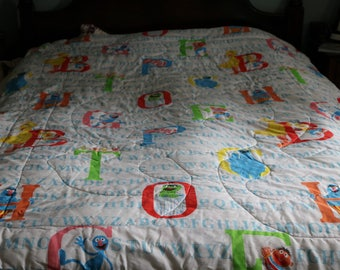 """Vintage Sesame Street, Muppet Characters©,  quilted comforter, blanket, comforter, bed spread, Very large 60""""X87"""" , Alphabet letters"""