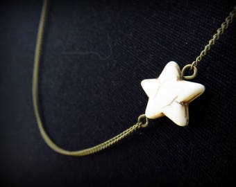 Long asymmetrical brass and white howlite star necklace