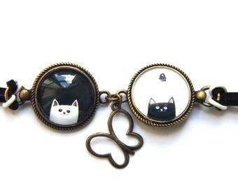 Bracelet two medallions black and white cat