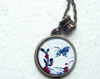 flowers and Butterfly under glass cabochon pendant