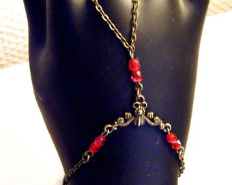 Slave bracelet with red glass beads
