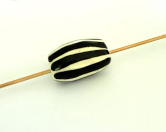 black hand molded ceramic bead and white-unique