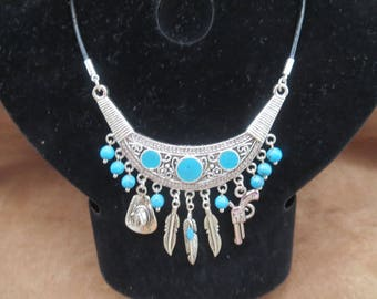 Necklace country earrings with turquoise feathers hat and gun