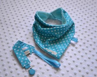 Turquoise bandana bib and his pacifier