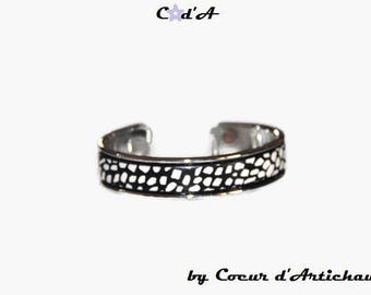 Bangle is silver and black and white leather