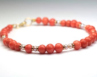 Bracelet 750 gold with precious corals and pearls