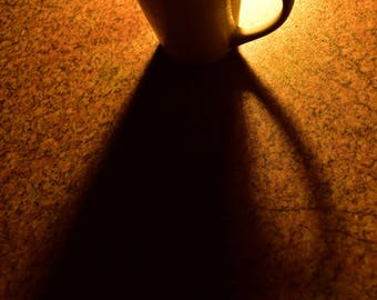 Photograph Cup of coffee in the morning sunshine