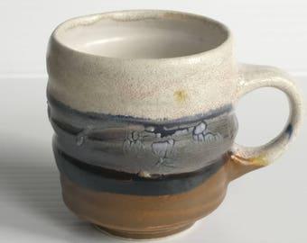 Pair of 8 oz CDP dark blue and brown mugs
