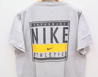 Vintage NIKE Athletics Performance Sportswear Gray Tee T Shirt