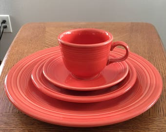 Vintage 4 pc. Fiestaware red/orange coffee cup, saucer, luncheon and dinner plates