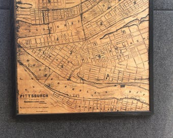 Pittsburgh map silk screened onto wood. Sold framed