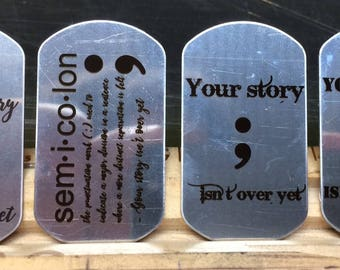 Laser-engraved Project Semicolon necklaces