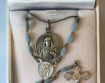 One highly collectable solid silver Lasserre on a sterling silver chain plus a rosary
