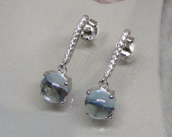Earrings in sterling silver and clear blue topaz