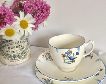 Newhall porcelain Art Deco tea cup, saucer and cake plate. White with blue flowers.