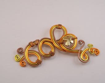 Butterfly brooch in yellow, orange and Brown striped
