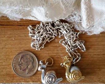 Vintage Joan Rivers Noah's Ark silver and gold tone metal and pearl snail charms with sterling chain