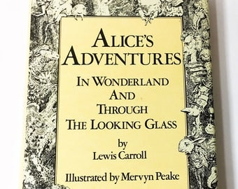 Alice's Adventures in Wonderland and Through the Looking Glass : And What Alice Found There. Vintage book circa 1985.  Book lover gift.