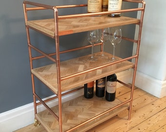 3 tier drink trolley in a retro industrial style with polished copper frame and reclaimed oak herribone panels