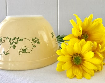 Yellow Pyrex mixing bowl with flowers 401