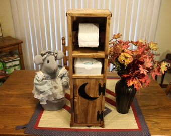 Handmade toilet paper stand and holder with storage.