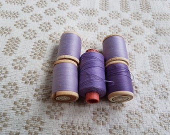 Set of five thick cotton violet thread on wooden spools produced in the Soviet Union for sewing textile, crochet in good condition