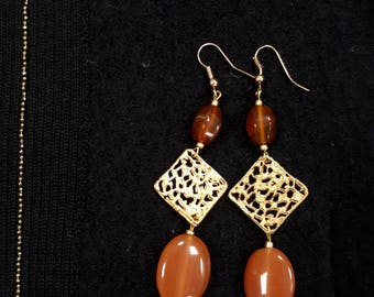 Carnelian and tunnels, dangling earrings with carnelian.
