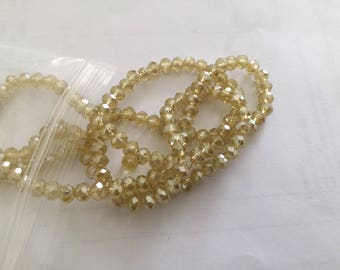 A 4 mm yellow faceted Crystal bead