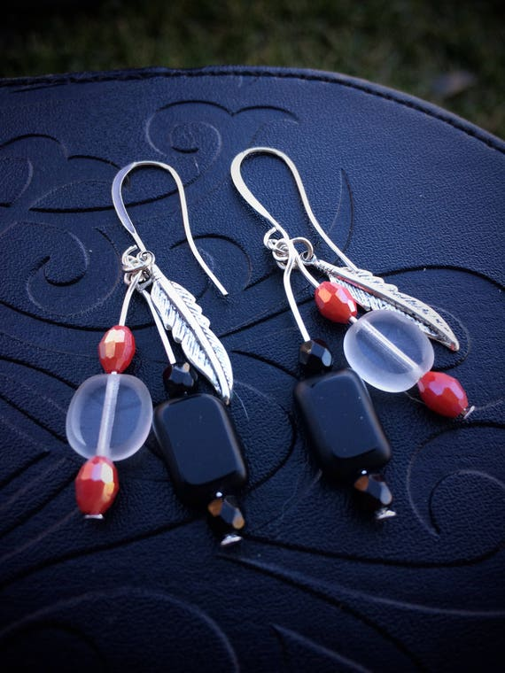 Feather earrings with red accents