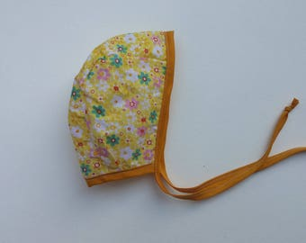 Yellow floral baby bonnet 0-3months