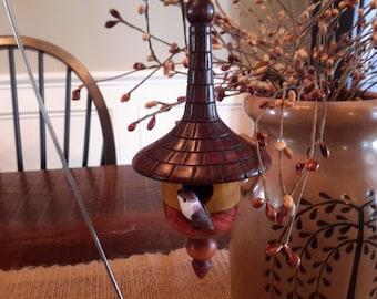 Wood turned handmade birdhouse.