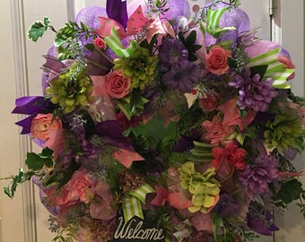 Floral wreath ponk, purple, greens accented with green/white ribbon