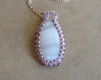 297 Off zag weaved amethyst and oval silver sowbelly agate