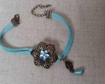 Bracelet bronze flower and blue ribbons