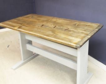 Reclaimed wooden table with painted legs